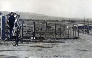 A sentry guards the entrance to Cassel POW Camp (CC BY-SA 3.0 via Wikimedia Commons)