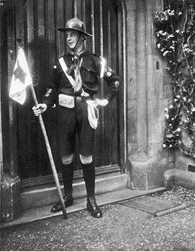 Harvey Watts in Scout Patrol Leader uniform outside KN vicarage